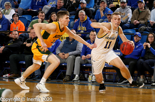 BROOKINGS, SD - JANUARY 22: Noah Freidel #11 of the South Dakota State Jackrabbits drives to the basket against Chris Quayle #13 of the North Dakota State Bison at Frost Arena on January 22, 2020 in Brookings, South Dakota. (Photo by Dave Eggen/Inertia)