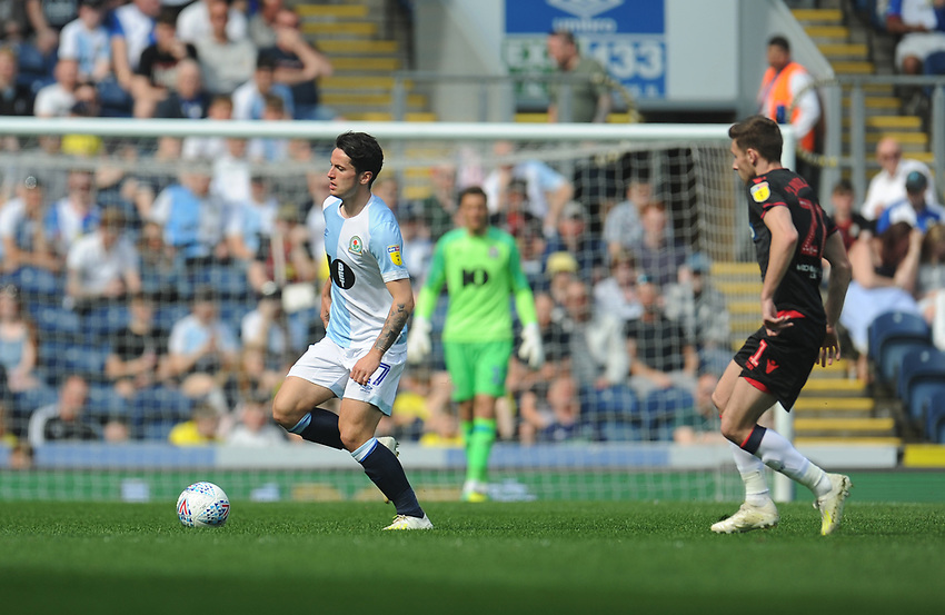 Blackburn Rovers' Lewis Travis under pressure from Bolton Wanderers' Joe Williams<br /> <br /> Photographer Kevin Barnes/CameraSport<br /> <br /> The EFL Sky Bet Championship - Blackburn Rovers v Bolton Wanderers - Monday 22nd April 2019 - Ewood Park - Blackburn<br /> <br /> World Copyright © 2019 CameraSport. All rights reserved. 43 Linden Ave. Countesthorpe. Leicester. England. LE8 5PG - Tel: +44 (0) 116 277 4147 - admin@camerasport.com - www.camerasport.com