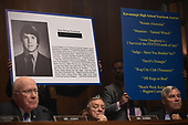 Extracts of his high school yearbook are displayed as Supreme Court nominee Brett Kavanaugh testifies before the US Senate Judiciary Committee on Capitol Hill in Washington, DC, September 27, 2018.  / POOL / SAUL LOEB