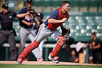 GCL Twins catcher Austin Hale (70) tracks down a loose ball in front of home plate umpire Kenny Jackson during the first game of a doubleheader against the GCL Orioles on August 1, 2018 at CenturyLink Sports Complex Fields in Fort Myers, Florida.  GCL Twins defeated GCL Orioles 7-6 in the completion of a suspended game originally started on July 31st, 2018.  (Mike Janes/Four Seam Images)