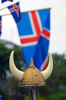 A viking helmet with the Icelandic flag in the background on a rainy day in Reykjavik, the capital of Iceland.