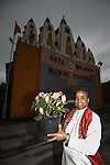 © Joel Goodman . 18 May 2013 . Gita Bhavan Hindu Temple , Withington Road , Whalley Range , Manchester . Acharya (instructor) Shyam Sunder Sharma holds plant to be planted on the temple grounds in front of the temple . Commemorative service to celebrate the handover of the Green Kumbh Yatra (green journey pot or environmental pilgrimage) at the Gita Bhavan Hindu Temple in Manchester . The pot has travelled to the Maha Kumbh Mela , Kenya , Nepal and the Western Wall in Jerusalem along the way . At every place of rest an environmental action must be taken to reflect the pot's environmental significance . It's due to travel to Leicester and feature in an outdoor procession in London on 24th May 2013 . Photo credit : Joel Goodman