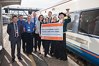 East Midlands Trains staff along with Lincoln Town Crier Karen Crow at the launch of the new Lincoln to Nottingham train timetable