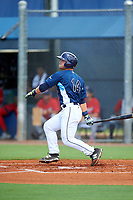 GCL Rays first baseman Erik Ostberg (14) hits a sacrifice fly during the first game of a doubleheader against the GCL Twins on July 18, 2017 at Charlotte Sports Park in Port Charlotte, Florida.  GCL Twins defeated the GCL Rays 11-5 in a continuation of a game that was suspended on July 17th at CenturyLink Sports Complex in Fort Myers, Florida due to inclement weather.  (Mike Janes/Four Seam Images)