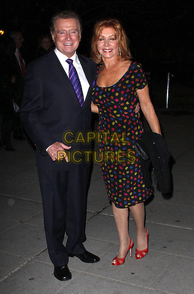 "REGIS & JOY PHILBIN.18 January 2011 - New York, NY.Philbin announced at the start of Tuesday morning ""Live With Regis and Kelly"" which he hosted for a quarter-century says that he is stepping down from the show around the end of the summer. .STOCK: 21 April 2009- New York, NY-   Regis Philbin and Joy Philbin.   8th Annual Tribeca Film Festival ""Vanity Fair Party"" held at State Supreme Courthouse New York City..full length black suit dress blue red yellow polka dot dress married husband wife .CAP/ADM/PZ.©Paul Zimmerman/AdMedia/Capital Pictures."