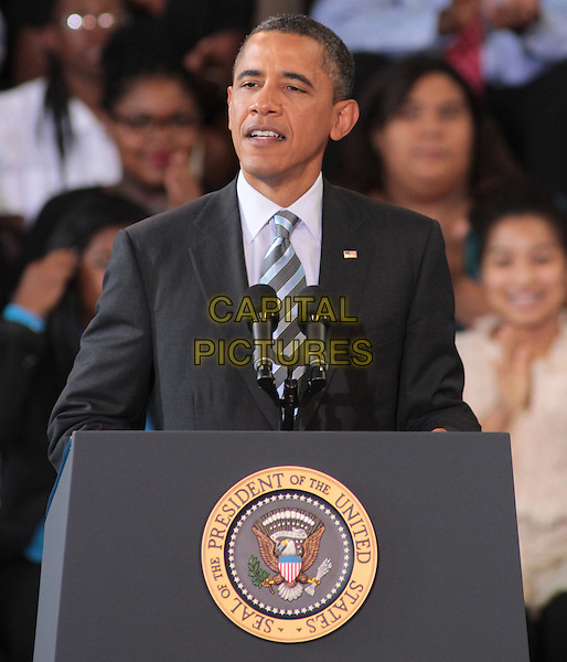 U.S. President Barack Obama delivers his third annual Back-to-School Speech at Benjamin Banneker Academic High School in Washington, DC., USA..September 28th, 2011 .government politics half length black suit jacket white shirt blue stripe tie podium speech.CAP/RKE/EML.©EML/RockinExposures/Capital Pictures.