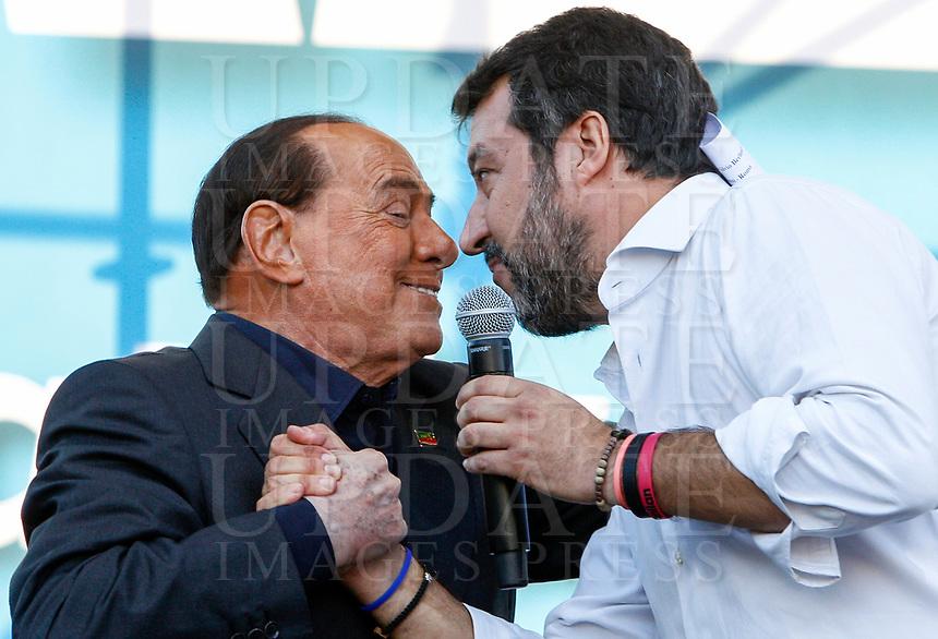 "Italian far-right League party's leader Matteo Salvini, right, greets Forza Italia leader Silvio Berlusconi during the so-called ""Italian Pride!"" political rally against government's economic policies in St. John Lateran Square, Rome, Italy, October 19, 2019.<br /> Update Images Press/Riccardo De Luca"