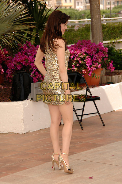"ROSE McGOWAN.""Death Proof"" photocall during the 60th International Film Festival, Cannes, France,.22nd May 2007.full length gold sequined dress shoes back behind over shoulder rear.CAP/PL.©Phil Loftus/Capital Pictures"