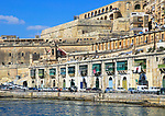 Historic waterfront buildings on Grand Harbour waterside, Valletta, Malta