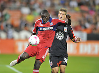 Bakary Soumare (4) of the Chicago Fire goes against Conor Doyle (30) of D.C. United.  The Chicago Fire defeated D.C. Untied 3-0, at RFK Stadium, Friday October 4 , 2013.