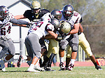 Palos Verdes, CA 09/16/16 - Joshua Evans (Torrance #22) and unidentified Peninsula player(s) in action during the Torrance - Palos Verdes Peninsula CIF Varsity football game.