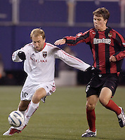The MetroStars' Michael Bradley looks to slow down Clint Mathis of Real Salt Lake. The weather was the story with 50 mph winds, rain, and a brief power outage as the MetroStars played Real Salt Lake to a scoreless tie during opening day action of season 10 of the MLS at Giant's Stadium, East Rutherford, on Saturday April 2, 2005.