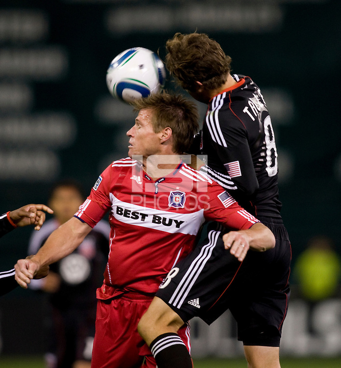 Brian McBride (20) of the Chicago Fire goes up for a header with Carey Talley (8) of DC United at RFK Stadium in Washington, DC.  The Chicago Fire defeated DC United, 2-0.