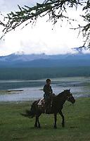 26 JUN 2002 - KHOVSGOL NATIONAL PARK, MON - A young Mongolian boy sits proudly astride is horse .(PHOTO (C) NIGEL FARROW)