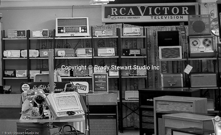 Client: Eiben and Irr Company<br /> Ad Agency:  Eiben and Irr Marketing<br /> Products: Department Store items<br /> Location: Wood Street and Liberty Avenue in Pittsburgh<br /> <br /> Location photography for Eiben and Irr's Holiday Catalog. New RCA record players and radios for sale at Eiben and Irr Department Store.  Eiben and Irr Jewelry and Department Store operated in downtown Pittsburgh at the corner of Wood Street and Liberty Avenue from 1953-1979.