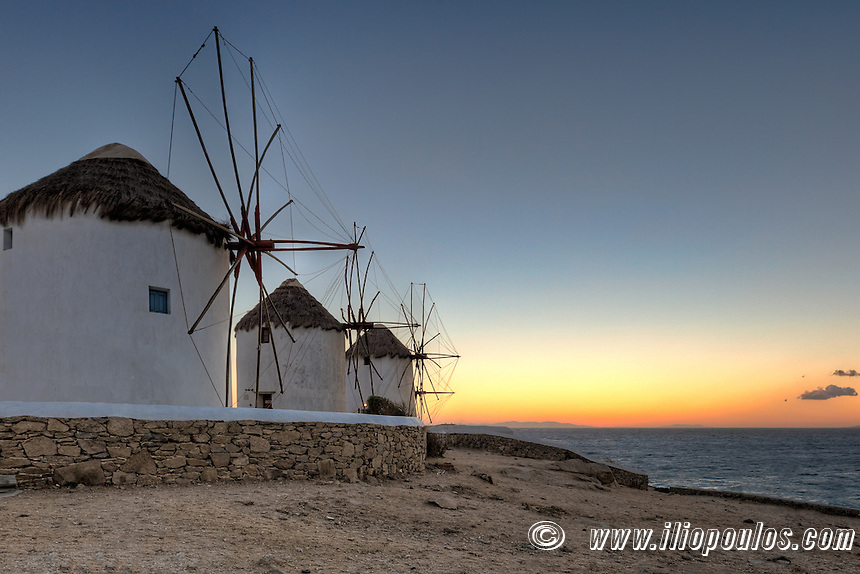 Sunset at the famous windmills of Mykonos, Greece