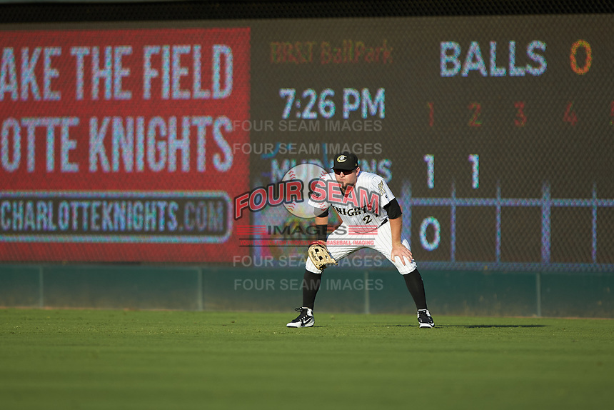 Charlotte Knights right fielder Mason Robbins (27) on defense against the Toledo Mud Hens at BB&T BallPark on June 22, 2018 in Charlotte, North Carolina. The Mud Hens defeated the Knights 4-0.  (Brian Westerholt/Four Seam Images)