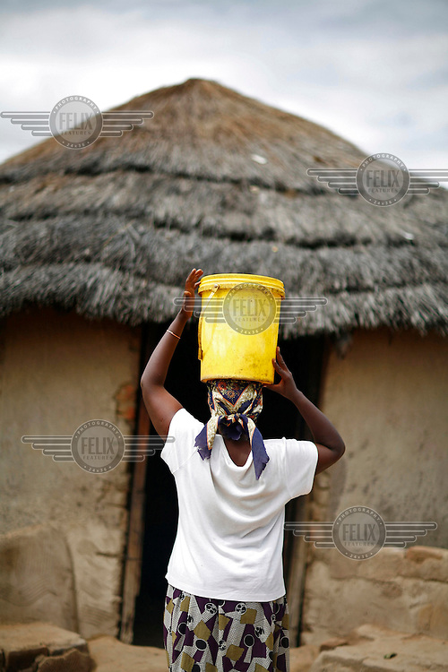 47 year old Skpabong collects water from the family well in rural Zimbabwe.