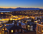 Seattle, Washington<br /> Evening view of the Olympic mountain skyline with hillside homes of the Magnolia and Interbay neighborhoods
