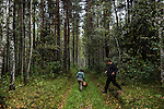 Vladimir Shashilov and Julia Schelkunova guide a mushroom hunt on Saturday, August 24, 2013 in Suzdal, Russia.