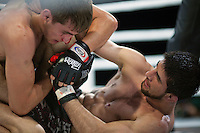 Moscow, Russia, 05/06/2010..A bloodied Marat Peksov struggles on the canvas with Rasul Mirzaev in a mix-fight bout during the new Fight Nights boxing tournament, featuring kick-boxing, boxing and mixed fighting.