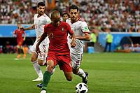SARANSK - RUSIA, 25-06-2018: Morteza POURALIGANJI (Der) jugador de RI de Irán disputa el balón con Joao MARIO (Izq) jugador de Portugal durante partido de la primera fase, Grupo B, por la Copa Mundial de la FIFA Rusia 2018 jugado en el estadio Mordovia Arena en Saransk, Rusia. / Morteza POURALIGANJI (R) player of IR Iran fights the ball with Joao MARIO (L) player of Portugal during match of the first phase, Group B, for the FIFA World Cup Russia 2018 played at Mordovia Arena stadium in Saransk, Russia. Photo: VizzorImage / Julian Medina / Cont