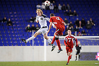 Steven Perry (11) of the Notre Dame Fighting Irish and Chase Rodgers (12) of the Louisville Cardinals go up for a header. The Louisville Cardinals defeated the Notre Dame Fighting Irish 1-0 during the semi-finals of the Big East Men's Soccer Championship at Red Bull Arena in Harrison, NJ, on November 12, 2010.