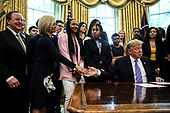 United States President Donald J. Trump shakes hands with Baylor women's basketball head coach Kim Mulkey as he welcomes the 2019 NCAA Division I Women's Basketball National Champions, the Baylor Lady Bears, in the Oval Office of the White House on April 29, 2019 in Washington, DC. <br /> Credit: Oliver Contreras / Pool via CNP