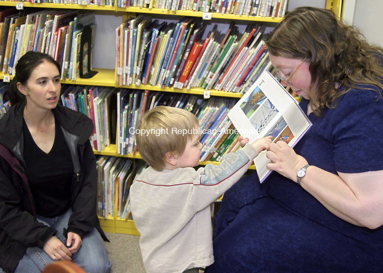 OXFORD, CT -27 APRIL 2007 - -042707DA01-- Timothy Cole 2, of Oxford leaves the side of his mom, Sarah to take a closer look of a book that the Children's Librarian, Dawn Higginson, reads to children Friday at the Babies and Books program at Oxford Public Library. <br />  Darlene Douty/Republican-American
