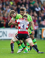 Northampton Saints' Jamie Gibson is tackled by Gloucester Rugby's Tom Savage <br /> <br /> Photographer Ashley Western/CameraSport<br /> <br /> Aviva Premiership - Gloucester v Northampton Saints - Saturday 7th October 2017 - Kingsholm Stadium - Gloucester<br /> <br /> World Copyright &copy; 2017 CameraSport. All rights reserved. 43 Linden Ave. Countesthorpe. Leicester. England. LE8 5PG - Tel: +44 (0) 116 277 4147 - admin@camerasport.com - www.camerasport.com