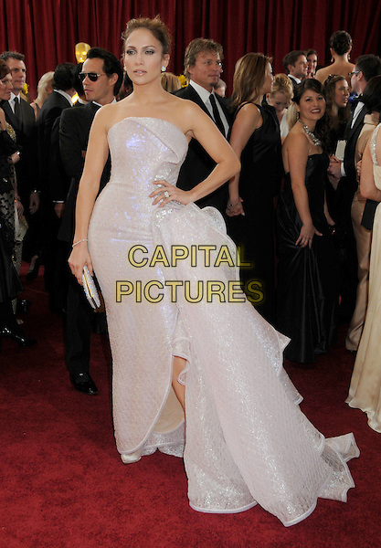 JENNIFER LOPEZ .wearing Armani Prive .Attending the 82nd Annual Academy Awards held at the Kodak Theatre, Hollywood, California, USA, .March 7th, 2010..oscars arrivals full length strapless dress cream sparkly nude beige off white clutch bag hair up bun hand on hip Armani Prive slit split clutch bag shiny .CAP/ADM/BP.©Byron Purvis/Admedia/Capital Pictures