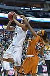 forward Nina Davis (13) drives past guard Ariel Atkins (24) during Big 12 women's basketball championship final, Sunday, March 08, 2015 in Dallas, Tex. (Dan Wozniak/TFV Media via AP Images)