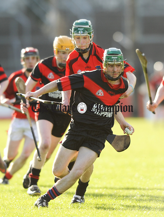 """Oisin Hickey of Meelick in action against Colin Burke of Whitegate during their U-21 """"C"""" county championship final at Cusack Park. Photograph by John Kelly."""