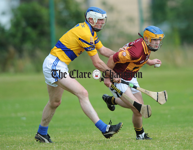 Tulla's Shane Mc Namara in action against Cratloe's Barry Duggan during a Commemorative 11 A-side hurling tournament, to celebrate 125 years of Clare club championships at Clarecastle. Photograph by John Kelly.
