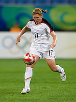 Lori Chalupny, Ria Percival. The USWNT defeated New Zealand, 4-0, during the 2008 Beijing Olympics in Shenyang, China.  With the win, the USWNT won group G and advanced to the semifinals.