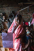 21 year old Seema Devi poses with her 9 month old daughter, Vaishnavi Kumari in the small room of their hut in Shivpur Hariyya village in Raxaul district of Bihar.