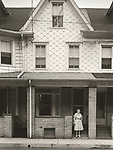 Scan of vintage print. 1980. Negative file #80-185-2. Row home with occupant. Shamokin, PA.