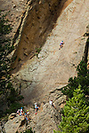 Kids climbing Christmas Rock at Cheley Camp, summer, Estes Park, Colorado, not released