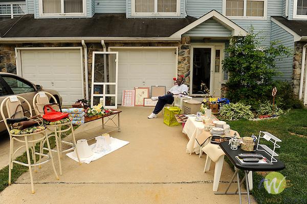 Parkside Muse, Community yard sale. Sicklerville, NJ. Phillip S. Warner, Sr. in front of house with sale stuff.
