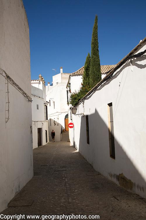 Narrow historic village street of Arcos de la Frontera, Cadiz province, Spain