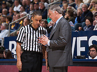 California's Head Coach Mike Montgomery discussing with referee during a game against USC at Haas Pavilion in Berkeley, California on February 23th, 2014. California defeated USC 77 - 64