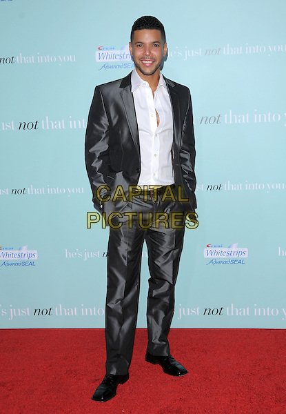 "WILSON CRUZ.""He's Just Not That Into You"" Los Angeles Premiere at Grauman's Chinese Theatre, Hollywood, California, USA..February 2nd, 2009.full length white shirt shiny grey gray silver suit hands in pockets .CAP/DVS.©Debbie VanStory/Capital Pictures."