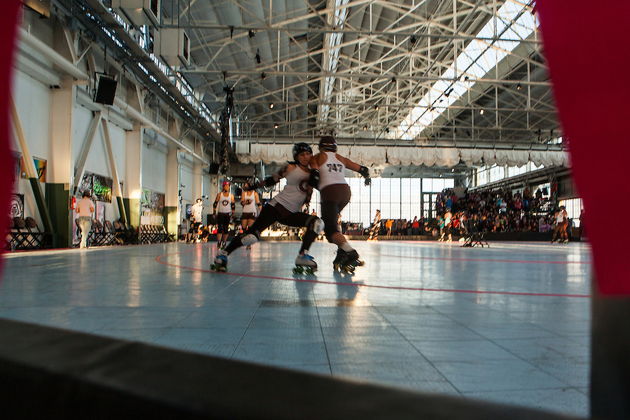 "A ""sun delay"" at the 2012 WFTDA Western Regionals in Richmond, California delayed the last two bouts at the Craneway Pavilion."