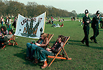 POLICE AND PROTESTERS WITH LARGE BANNER PRONOUNCING ' LEGALISE IT NOW' AT LEGALISE POT DEMO, HYDE PARK LONDON, 1979,