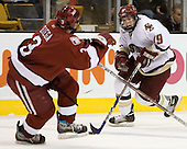 Brock Bradford (Boston College - Burnaby, BC) carries the puck against Alex Biega (Harvard University - Montreal, PQ). The Boston College Eagles defeated the Harvard University Crimson 3-1 in the first round of the 2007 Beanpot Tournament on Monday, February 5, 2007, at the TD Banknorth Garden in Boston, Massachusetts.  The first Beanpot Tournament was played in December 1952 with the scheduling moved to the first two Mondays of February in its sixth year.  The tournament is played between Boston College, Boston University, Harvard University and Northeastern University with the first round matchups alternating each year.