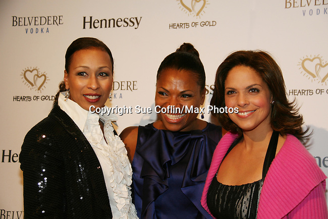 """Tamara Tunie and Soledad O'Brien are co-mistresses pose with Deborah Koenigsberger is event chair of The Hearts of Gold 13th Annual Gala """"It's a Love Thing"""" - a benefit gala for Hearts of Gold on November 12, 2009 at the Metropolitan Pavilion, NYC, NY. (Photo by Sue Coflin/Max Photos)"""