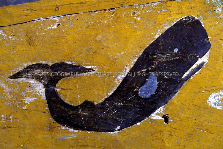 Lamalera, Indonesia..A sperm whale talisman painted on the sides of a whaling boat...Photograph by Stuart Isett.©2003 Stuart Isett