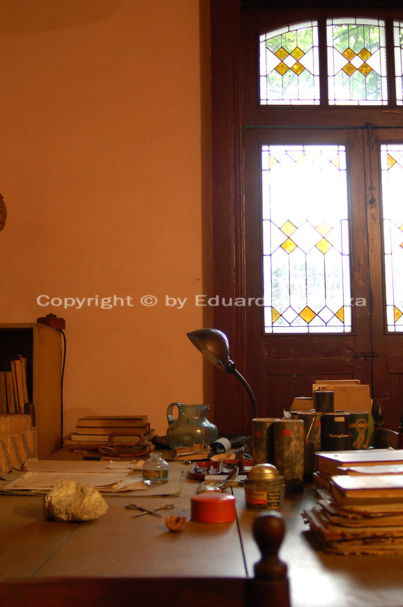 "Coyoacan, Mexico City - Leon Trotsky's study in his house in Mexico City.  The Leon Trotsky House Museum is a venue honoring Leon Trotsky's life.  The venue displays memorabilia such as photographs, newspapers and Trotsky personal effects.  The site also houses an organization that works to promote political asylum.  The museum is a favorite destination of millions of tourists every year, and it is located in the Coyoacan borough of Mexico City.  The museum was built next to the house in which Trotsky lived with his second wife Natalia Sedova from 1939 to 1940, and where the Russian dissident was also murdered and buried.  The house has been preserved as it was at that time where Trotsky lived there, in particular the study in which Joseph Stalin' supporter Ramon Mercader killed Trotsky with an ice axe to the back of the head.  Around the house is a garden and high walls with watchtowers.  The complex was turned into the current museum and asylum institution in 1990, on the 50th anniversary of the assassination.  Coyoacan's name comes from Nahuatl it likely meaning ""place of coyotes"".  Hernán Cortes and the Spanish conquistadors used this area as a headquarters during the Spanish conquest of the Aztec Empire. They also made it the first capital of New Spain between 1521 and 1523.  In recent times, has been a counterculture hotbed and where Frida Kahlo and Diego Rivera lived, a few blocks away from Leon Trotsky.  Due the historic and cultural relevance, their homes are now the Frida Kahlo Museum and the Leon Trotsky Museum, which are visited by thousands of tourists every year.  Modern-day Coyoacan is a quiet residential area with cobblestone streets, restaurants, parks, squares, and a favorite hangout for bohemia enthusiasts. Photo by Eduardo Barraza © Copyright"