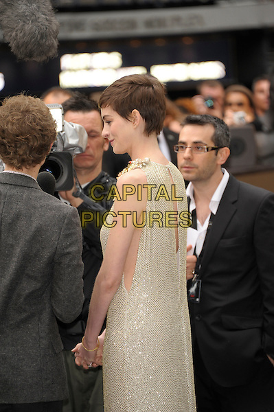 Anne Hathaway (wearing Gucci).'The Dark Knight Rises' European premiere at Odeon Leicester Square cinema, London, England..18th July 2012.half side length embellished jewel encrusted flowers floral pearls collar short cropped hair sleeveless silver gold cream beige dress cut out sides profile.CAP/PL.©Phil Loftus/Capital Pictures.