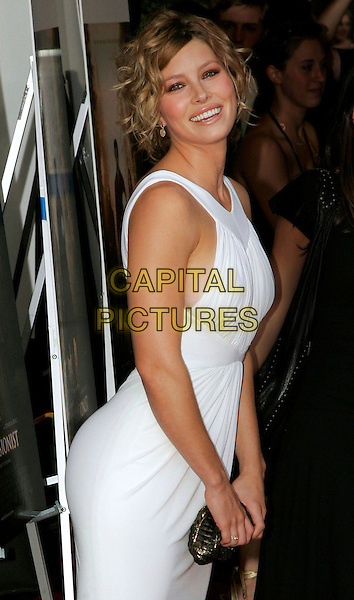 """JESSICA BIEL.At the NY Premiere of """"The Illusionist"""" at Chelsea West Theatre - Outside Arrivals, New York, NY, USA..August 15th, 2006.Photo: Jackson Lee/Admedia/Capital Pictures.Ref: ADM/JL.half length white dress black clutch purse.www.capitalpictures.com.sales@capitalpictures.com.©Jackson Lee/AdMedia/Capital Pictures."""